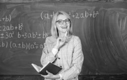 Qualities that make good teacher. Woman teaching near chalkboard. Principles can make teaching effective and efficient. Effective teaching involve acquiring royalty free stock photos