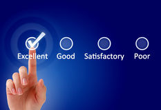 Quality. Hand and checklist over blue background Royalty Free Stock Photo