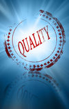 Quality. Red quality stamp on a blue background Royalty Free Stock Photography