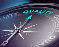 Quality Assurance Concept. Compass needle pointing the blue text. Blue and black tones with blur effect and focus on the main word. Concept for quality assurance Royalty Free Stock Photos