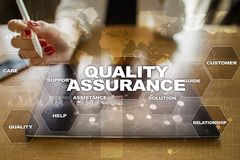 Quality assurance concept on the virtual screen. Business concept. Quality assurance concept on the virtual screen. Business concept stock photos