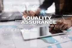 Quality assurance concept on the virtual screen. Business concept. Quality assurance concept on the virtual screen. Business concept Stock Image