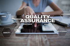 Quality assurance concept on the virtual screen. Business concept. Quality assurance concept on the virtual screen. Business concept Royalty Free Stock Image