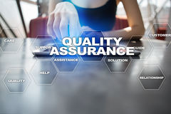 Quality assurance concept on the virtual screen. Business concept. Quality assurance concept on the virtual screen. Business concept Royalty Free Stock Images