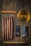 quality cigars with cognac, lighter and cutter Stock Photo