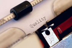Quality control. Word quality on a paper in a typewriter Royalty Free Stock Image