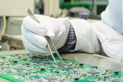 Quality control and assembly SMT printed components on PCB. Quality control and assembly of SMT printed components on circuit board in QC lab of PCB royalty free stock images