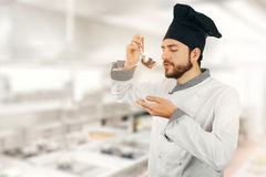 Quality control - chef tasting soup from ladle royalty free stock images