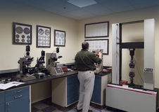 Quality control lab. Quality control analyst in a lab performing various quality control tests Stock Images