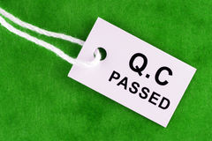Quality Control Passed. Tag over green background Stock Images