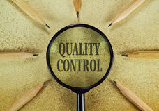 Quality control. Pencils and magnifier in a conceptual image about controlling the quality Stock Photo