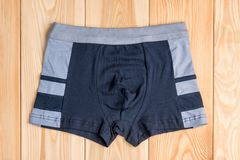 Quality cotton panties for boy clothes on wooden boards. Top view royalty free stock images