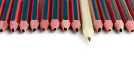 Quality guarantee. Quality assurance concept using broken decorative pencils and reliable blank pencil Royalty Free Stock Photos