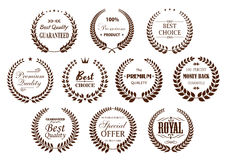 Quality guarantee icons with brown laurel wreaths stock illustration