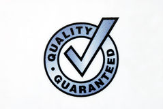 Quality guaranteed sign isolated on the white Stock Photos