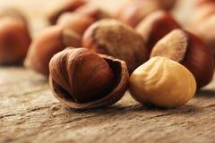 Hazelnuts on wooden table Stock Photos