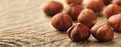 Hazelnuts on wooden table Royalty Free Stock Photography