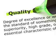 Quality highlighted in green. Definition of the word Quality highlighted in green with felt tip pen Royalty Free Stock Photography