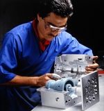 Quality Inspector at work. Checking aan aluminum mold Stock Photography