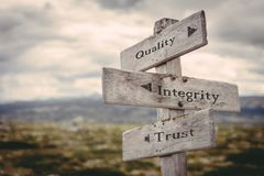 Quality, integrity, trust signpost in nature. royalty free stock photos