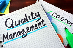 Quality Management System QMS. Quality Management System QMS written on a notepad with marker Stock Photos