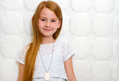 Quality mattress. Smiling young girl with orthopedic mattress. Quality mattress Stock Images