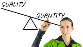 Quality over quantity. Young female drawing scale showing quality over quantity concept Stock Image