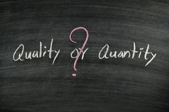 Quality or quantity. Written on blackboard Royalty Free Stock Images