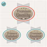 Quality and satisfaction guarantee badges. Satisfaction Guarantee and Premium Quality badges, in English, Spanish and German languages, vector vintage collection royalty free illustration