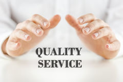 Quality Service. Conceptual image depicting customer satisfaction and quality reliable service and guaranteed support with a mans hand cupped protectively over Stock Images