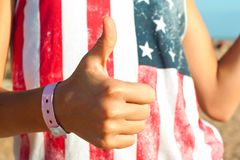 Quality sign -  thumb up. It`s ok! I am satisfied!. Summertime outdoors Stock Photo