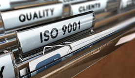 Quality Standards ISO 9001. Close up on a file tab with the word ISO 9001, focus on the main text and blur effect. Concept image for illustration of Quality royalty free illustration