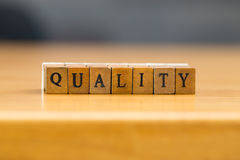 Quality. word written on wood block stock photography