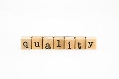 Quality wording isolate on white background Stock Photos
