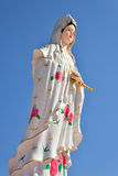 Quan yin. Statue with blue sky background Stock Photo