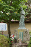 Quan Yin statue in garden of Hikakokubun-ji Buddhist Temple. Stock Photography