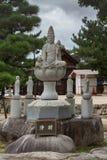 Quan Yin statue outside the Daiganji Buddhist Temple. Hiroshima, Japan - September 20, 2016: Stone Quan Yin statue outside the Daiganji Buddhist Temple. She Royalty Free Stock Images