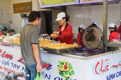 Quang Ninh, Vietnam - Mar 22, 2015: Grilled chopped cuttlefish stall at Ha Long market. The food is very famous in Ha Long city.  stock images