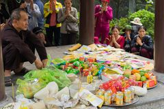 Quang Ninh, Vietnam - Mar 22, 2015: Vietnamese buddhist offerings in Cai Bau temple . Visiting pagoda in spring is Vietnamese budd. Hist traditional culture Stock Photos