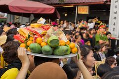 Quang Ninh, Vietnam - Mar 22, 2015: Vietnamese people bring offerings to Cai Bau temple . Visiting pagoda in spring is Vietnamese. Buddhist traditional culture Royalty Free Stock Photos