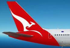 Quantas, Australian airlines plane. Logo of Quantas, Australian airlines company is on the tail of plane. The blue sky area is free for your text Royalty Free Stock Photos