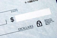 Quantità del dollaro sull'assegno fotografie stock