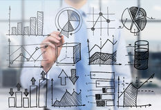 Quantitative analyst is drawing different charts on the glass screen. Royalty Free Stock Photos