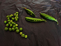 A quantity of peas. Lots of green peas on grey background Royalty Free Stock Photos