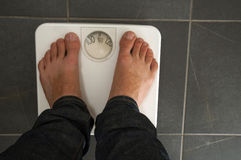 Quanto peso? Fotografie Stock Libere da Diritti