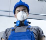 Quarantine. Construction worker with protection equipment Stock Image