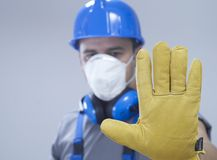 Quarantine. Construction worker with protection equipment Stock Photos