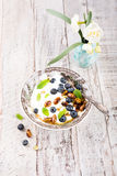 Quark with blueberries, pistachios and mint Stock Photo