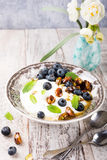 Quark with blueberries, pistachios and mint Stock Photography
