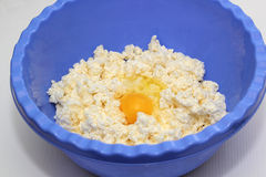 Quark dough with egg. In a bowl Royalty Free Stock Images